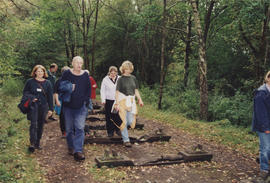 Photograph of people walking across sculpture Iron Road