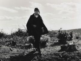 Photograph of Magdalena Jetelová walking in area where sculpture Place/ Giant's Chair was to be located