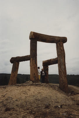 Photograph of two people stood underneath Place/ Giant's Chair