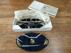 Original Thomas Plant & Company Limited box containing two St Paul's College sports caps...